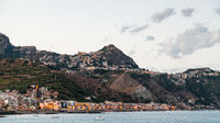 Giardini Naxos town below and Taormina city above