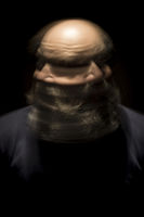 motion blur portrait of a bearded bald head man