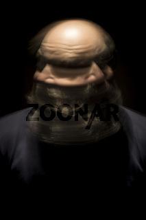 motion blur portrait of a bearded bald head man