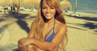 African Girl in Bikini Resting at Beach Bench