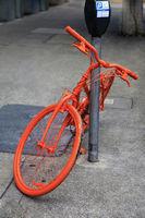 Parked orange bike