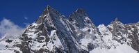 Pointed peak of Khumbila, also named Khumbu Yul Lha. Mountain god in the Sherpa culture.