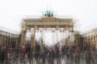 multi exposure of Brandenburg Gate with tourist crowd in Berlin Germany