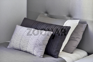 Pillows in a row on the bed in the bedroom