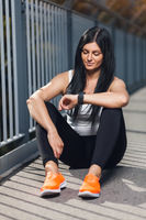 City workout. Beautiful young woman with a smartwatch training in an urban setting