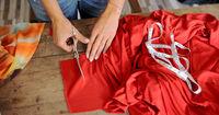 Crop female cutting fabric