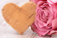 rose flower with heart as symbol for love
