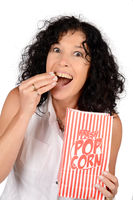 Woman eating popcorn.