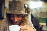 bearded guy drinking coffee