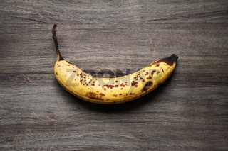 ripe banana with brown spots