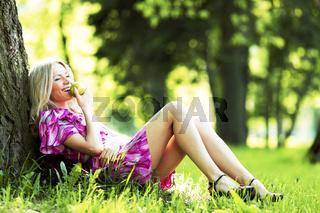 Woman sitting under tree