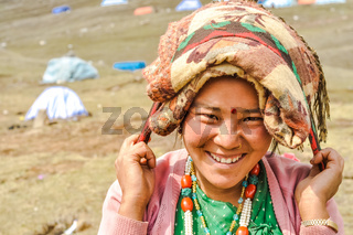 Smiling woman with red dot in Nepal
