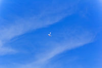 Military airplane in blue sky