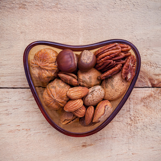 Selection food sources of omega 3 and unsaturated fats. Super food high vitamin e and dietary fiber for healthy food. Almond ,pecan ,hazelnuts and walnuts on wooden background flat lay.