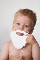 Baby boy with white Santa Claus fake beard