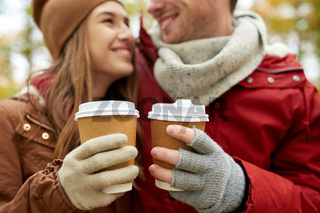 close up of happy couple with coffee in autumn