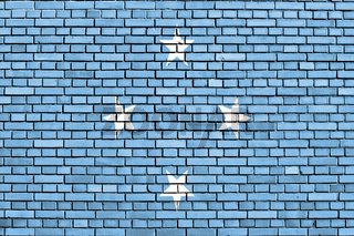 flag of Micronesia painted on brick wall
