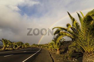 Regenbogen mit Strasse, Rainbow with street