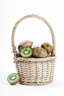 wicker basket full of fresh juicy kiwi fruits