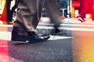 Business man crossing the street