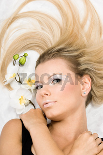 beautiful woman with white orchids