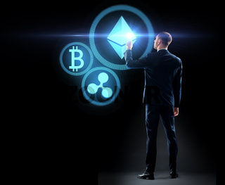 buisnessman with cryptocurrency holograms