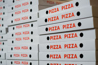 stack of pizza boxes , many pizza cartons