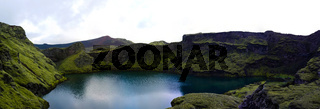 Lake in Tjarnargigur volcano crater