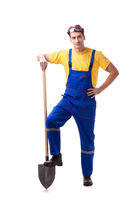 Contractor in blue coveralls with spade on white background