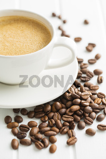 Hot coffee cappuccino and coffee beans.
