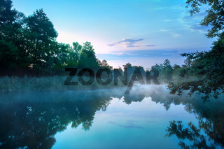 Morning fog on a calm river