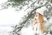 Cute young woman in wintertime outdoor