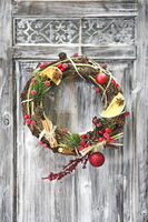 Christmas handmade wreath on wooden door.