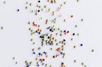 Many small shiny polished glass beads -  macro photo