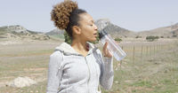 Female drinking water during workout