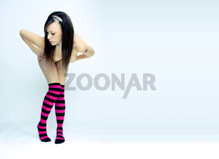 image of beautyfull topless woman with striped socks on isolated background