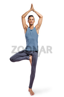 Young man doing yoga isolated on white