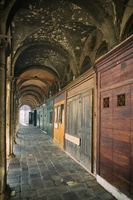 The arcade with small shops before opening close to the fish market in Venice