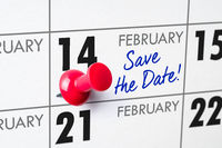 Wall calendar with a red pin - February 14