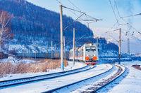 Freight train moves along Baikal lake.