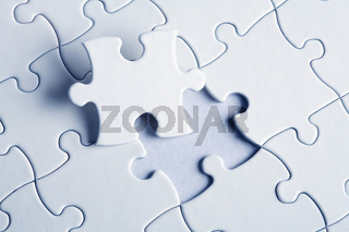 jigsaw puzzle with the missing piece