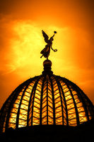 an angel at Dresden Germany at sunset