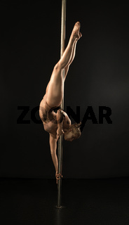 Gold skin woman posing on pylon studio shot