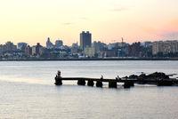 Sunset scene of beach and skyline at background, Montevideo, Uruguay
