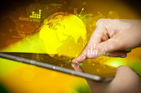 Hand touching tablet with global estate report concept