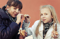 Teenage girls eating a burgers