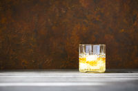 Glass of whiskey on dark background. Close up