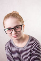 portrait of beautiful girl with glasses smiling