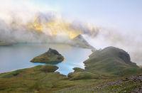 sunshine on rock by alpine lake
