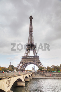 Eiffel tower surrounded by tourists